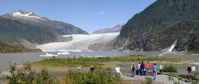 View of Mendenhall Glacier, Nugget Falls, and tourists from an overlook
